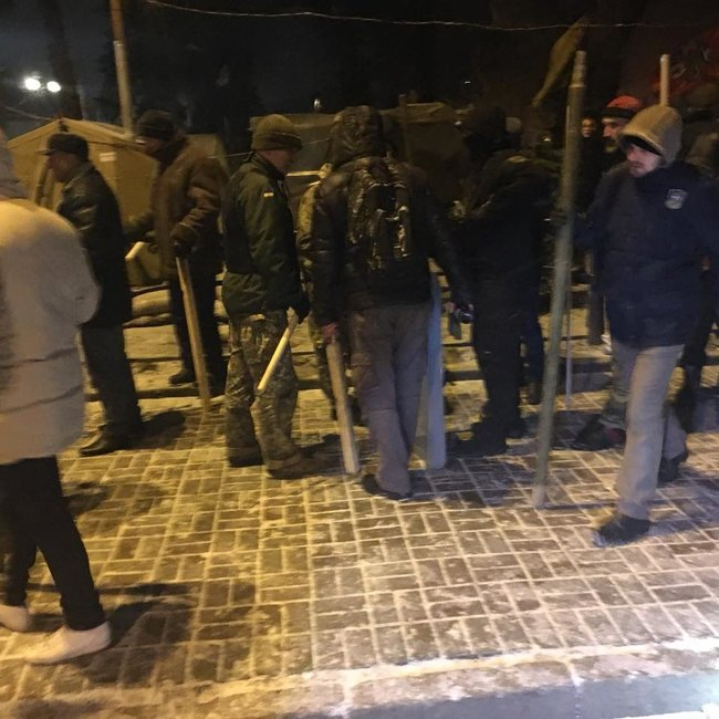 Clashes spark outside Ukrainian parliament as police try to locate Saakashvili in tent camp 02