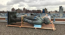 Lenin monument standing atop New York building since 1989 dismantled. PHOTOS