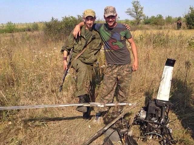 Russian officer and DPR militants taking pictures with downed OSCE drone 08