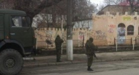 Armed people in cars on duty at military units in the cities of Simferopol and Saky. PHOTO