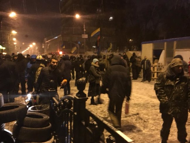 Clashes spark outside Ukrainian parliament as police try to locate Saakashvili in tent camp 03