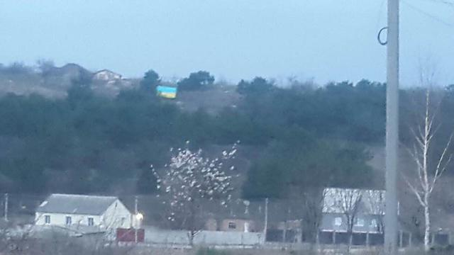 Ukrainian flag raised in Simferopol, - Isliamov 01