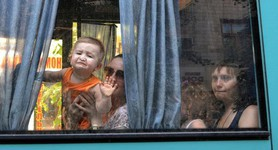 EVACUATING CHILDREN ALONG A DANGEROUS UKRAINE ROUTE