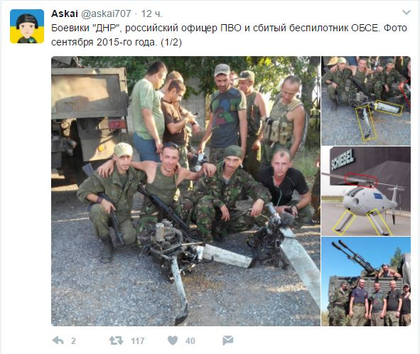 Russian officer and DPR militants taking pictures with downed OSCE drone 01